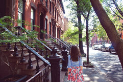 Girl walk at the Greenwich village. New York, United States - June 19, 2015: Girl walk at the Greenwich village down the Perry street on summer sunny day in the Royalty Free Stock Image