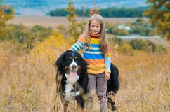 girl on walk with her dog friend on autumn hills stock photography