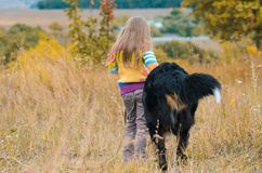 girl on walk with her dog friend on autumn hills royalty free stock photography