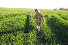 Free Girl Walk In The Green Field Royalty Free Stock Image - 184349236