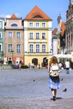 Girl walk at the main square Rynek of Poznan. Girl walk at the main square Rynek  of polish city Poznan Royalty Free Stock Photography