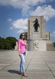 Girl on a walk at the memorial statue Stock Photo