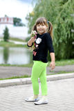 Girl on a walk in the park. Girl with bouquet on  Novodevichy par Stock Images