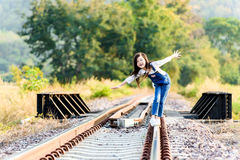 Girl walk on the railway Royalty Free Stock Photography