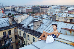 Girl walk on the roofs Royalty Free Stock Images