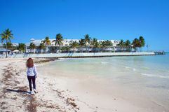 Girl walk at the sunny South Beach of Key West near Atlantic Ocean. Girl walk at the sunny South Beach of Key West near Atlantic Ocean, USA Stock Image