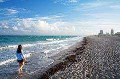 Girl walk at the sunny South Beach of Miami Royalty Free Stock Image