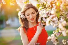 Girl on a walk among trees Stock Photo