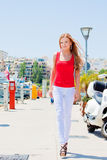 The girl walked down the street along the marina Royalty Free Stock Photo