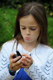 Girl with walkie talkie Stock Image