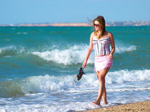 Girl walking. Girl walks on beach with romantics thought in head Royalty Free Stock Images