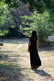 Girl walking. In a garden Royalty Free Stock Photography