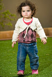 Girl walking. Little girl with blue eyes walking stock images