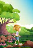 A girl walking above the rocks in the forest Stock Photos