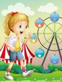 A girl walking across the carnival Stock Photo