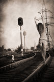 Girl walking alone along rail track Stock Photography