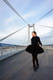 Girl walking alone on the bridge Royalty Free Stock Image