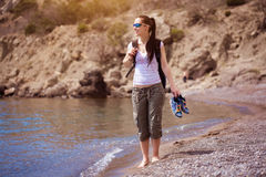 Girl is walking along the beach. tourism Stock Photo