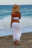 Girl walking along the beach Royalty Free Stock Photo