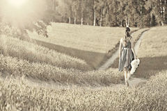 Girl walking along in  field Royalty Free Stock Photos