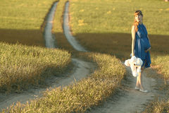 Girl walking along in  field Stock Image