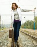 Girl walking along  railroad Stock Image