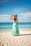 Girl walking along a tropical beach in the Maldive Stock Images