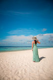 Girl walking along a tropical beach in the Maldives. Stock Image