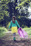 Girl walking along a woodland path Stock Photos