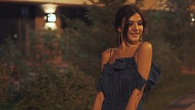 A girl is walking around the city on a summer night. stock footage