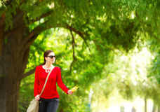 Girl walking in autumn park Royalty Free Stock Images