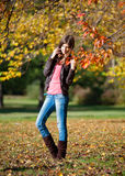Girl walking in autumn park Royalty Free Stock Photo