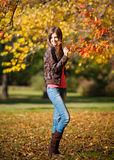 Girl walking in autumn park Royalty Free Stock Image