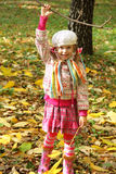 Girl walking in autumn park Stock Photo