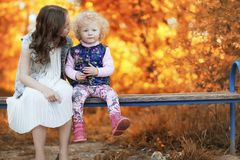 Girl walking in the autumn park. Autumn in the city, girl with d Royalty Free Stock Photo