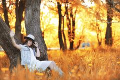 Girl walking in the autumn park. Autumn in the city, girl with d Royalty Free Stock Images