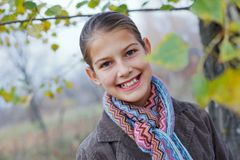 Girl walking in a autumn park Stock Images
