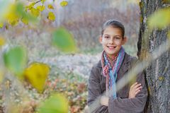 Girl walking in a autumn park Royalty Free Stock Photos