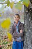 Girl walking in a autumn park Stock Image