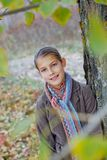 Girl walking in a autumn park Royalty Free Stock Image