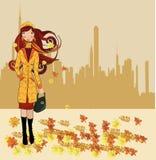 Girl walking on autumn street Royalty Free Stock Image