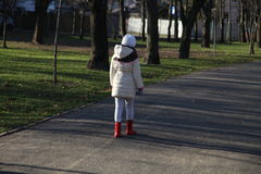 A girl walking away. A girl walking away in park royalty free stock images
