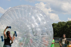 GIRL  IN WALKING BALLOON BUBBLES Stock Images