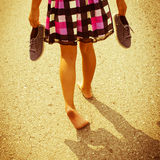 Girl Walking Barefoot Stock Image
