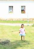 Girl walking barefoot Stock Image