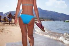 Girl walking on beach Royalty Free Stock Photos