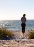 Girl walking on beach Stock Photos