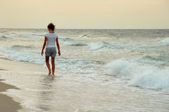 Girl walking on beach Royalty Free Stock Photos