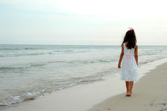 Girl Walking on Beach Royalty Free Stock Photography