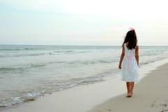 Girl Walking on Beach Royalty Free Stock Photography
